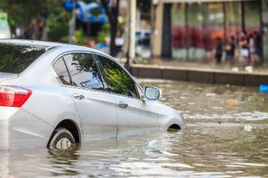 Silver car in flooding