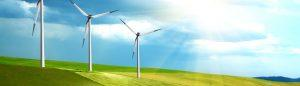 Wind turbines on a hill on a sunny day